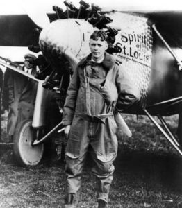"Charles Lindbergh stands in front of his ""Spirit of St. Louis"""
